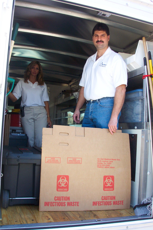 Cleaners standing inside work van